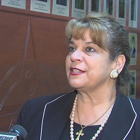 State Attorney Angela Corey wearing a cross representing her faith
