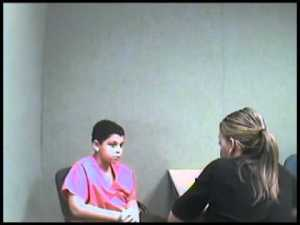 Cristian, age 12, being interviewed by a detective