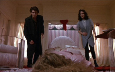 In the film Heathers two teens cover the murder of the school's most popular (and vicious) bully, setting off a series of bizarre and improbable occurrences.