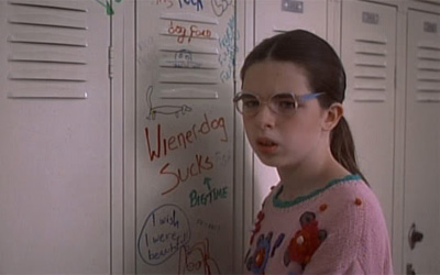 Heather Matarazzo played Dawn Wiener in the 1995 film Welcome to the Dollhouse. In the movie she is incessantly bullied and he family is either clueless about it, or they just don't care.